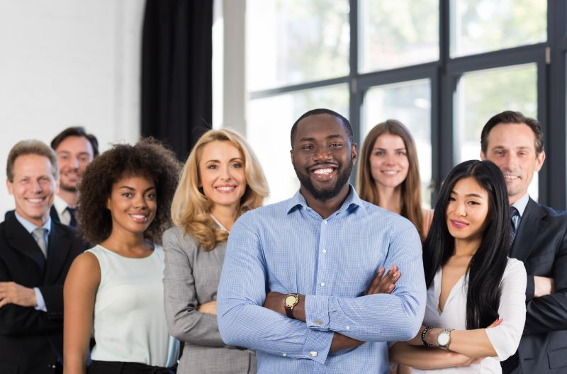 group of office workers, males and females of different races and ethnicities